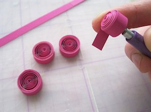Quilled flower bookmark tutorial splitcoaststampers if you dont have a quilling tool straighten a large paperclip and squeeze one end into a tight hook with pliers mightylinksfo